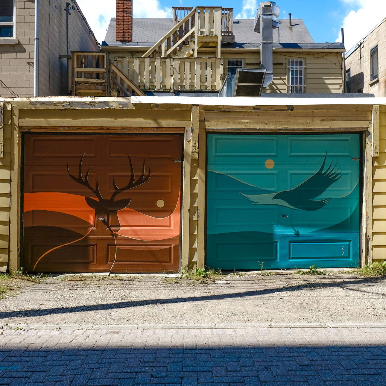 Photo of 2 paintings on garage doors